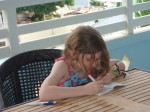 Writing in her journal on our balcony at Beaches Boscobel