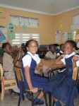 Jamaican children in school uniforms.