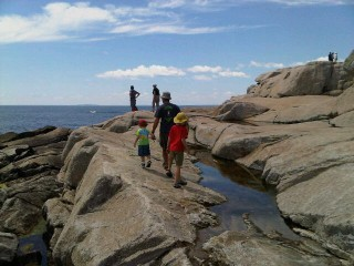 Choosing our picnic spot on the rocks
