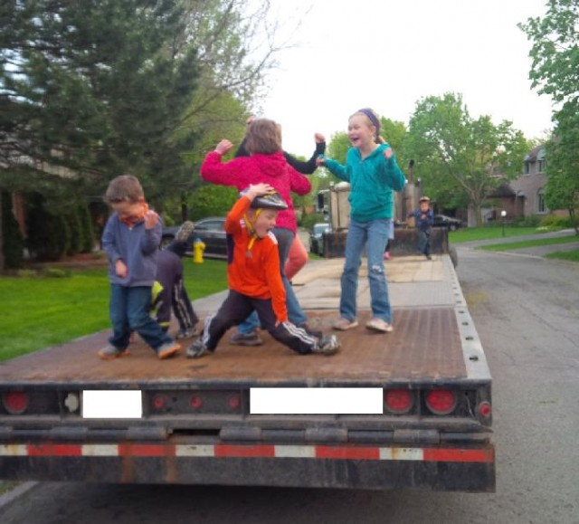 Kids dancing on flat bed truck
