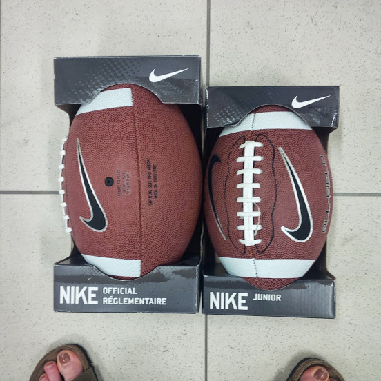 Two different sizes of footballs