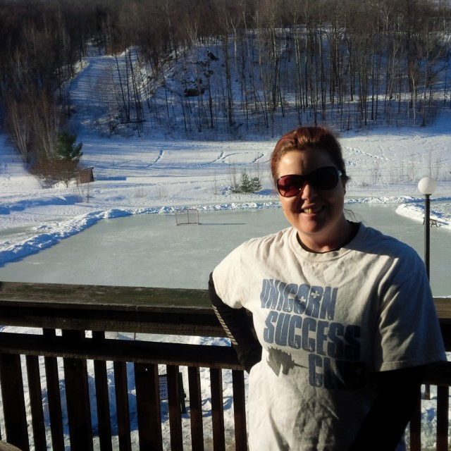 Enjoying some sun on the hotel room balcony. Check out the ice rink behind me!